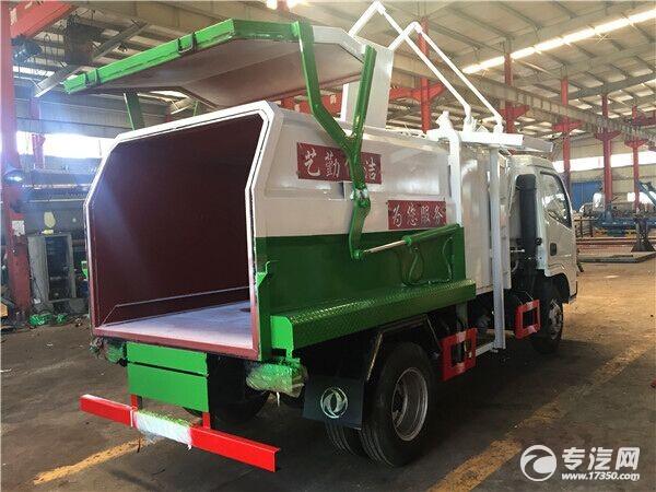 东风小多利卡侧装挂桶压缩式垃圾车开启状态