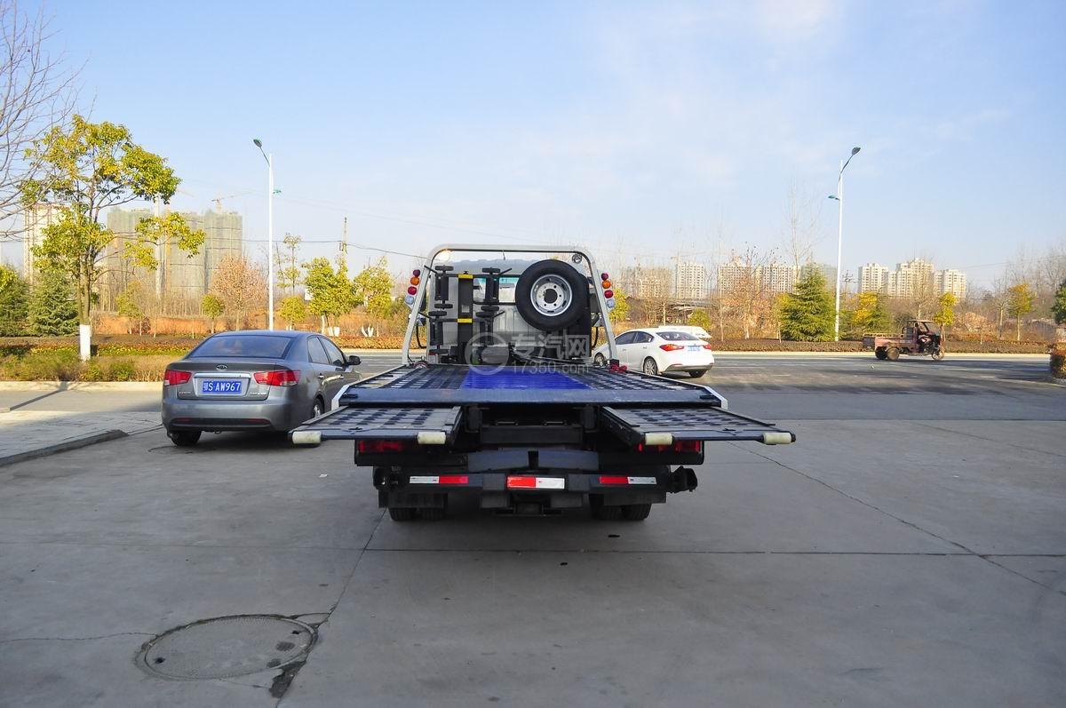 大运奥普力蓝牌一拖二平板清障车后面