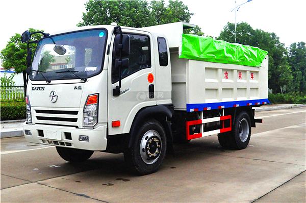 7大运奥普力带斗篷式自卸式垃圾车