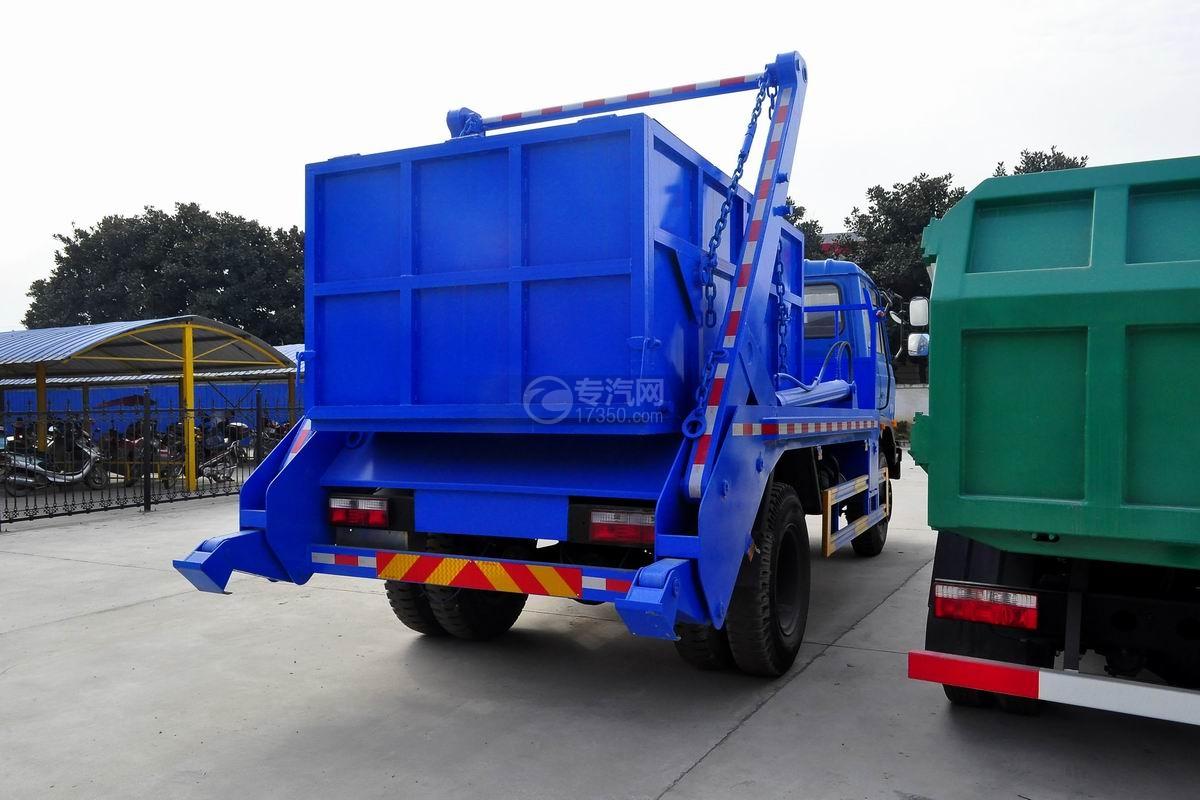 东风145摆臂式垃圾车侧后方图