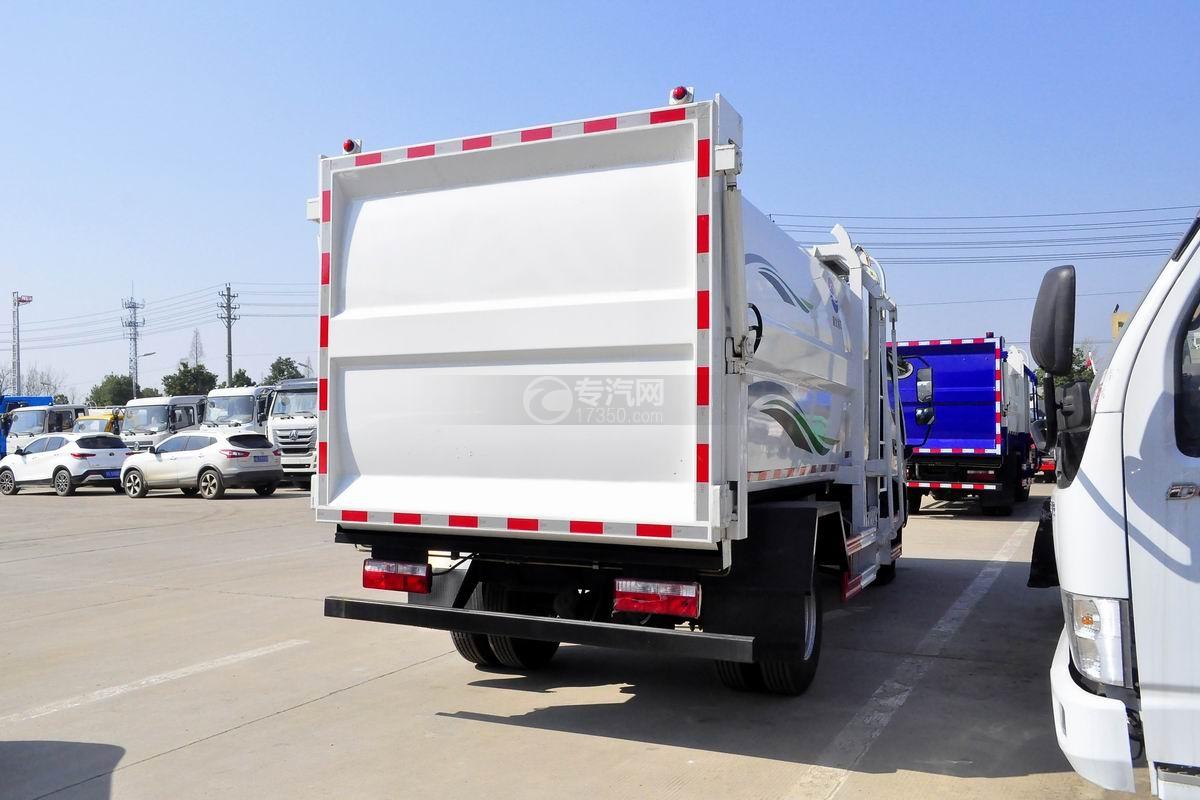 江淮骏铃E6自装卸式垃圾车侧后方图