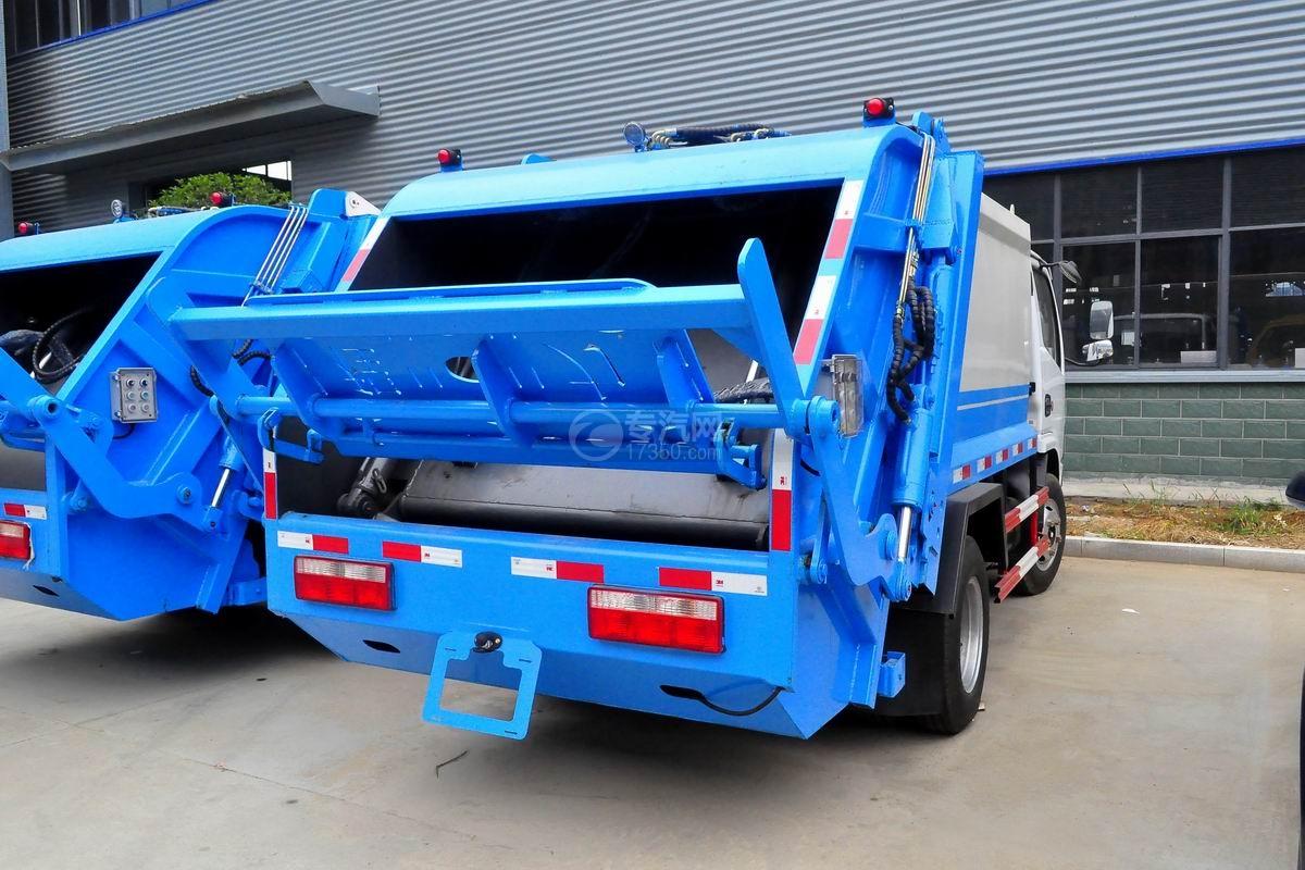 东风多利卡6方压缩式垃圾车侧后方图