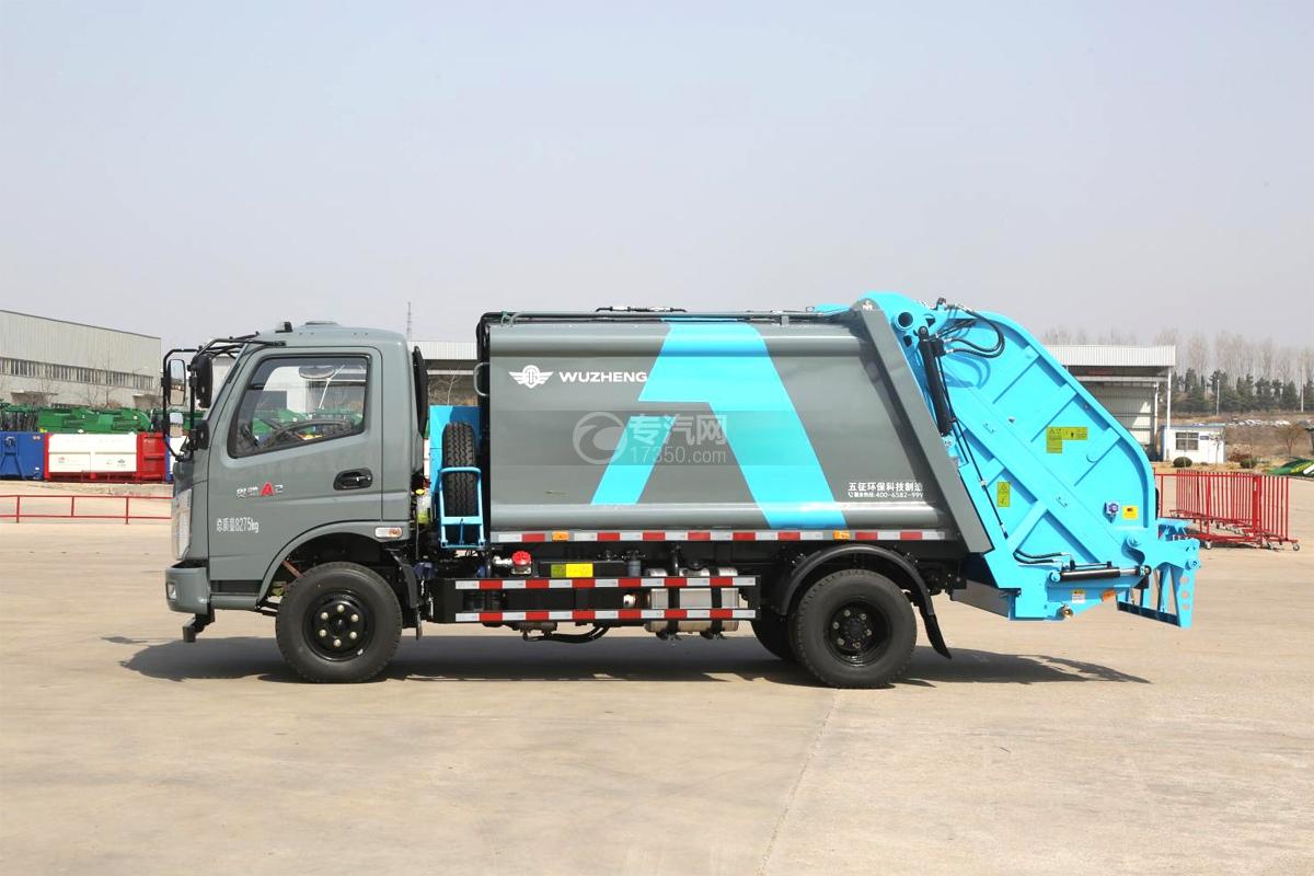 飞碟奥驰A2压缩式垃圾车左侧图