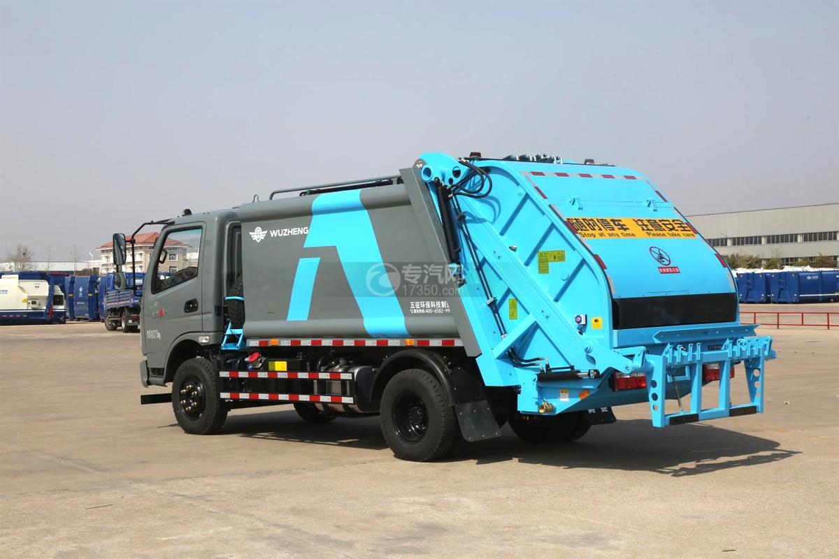 飞碟奥驰A2压缩式垃圾车左后图