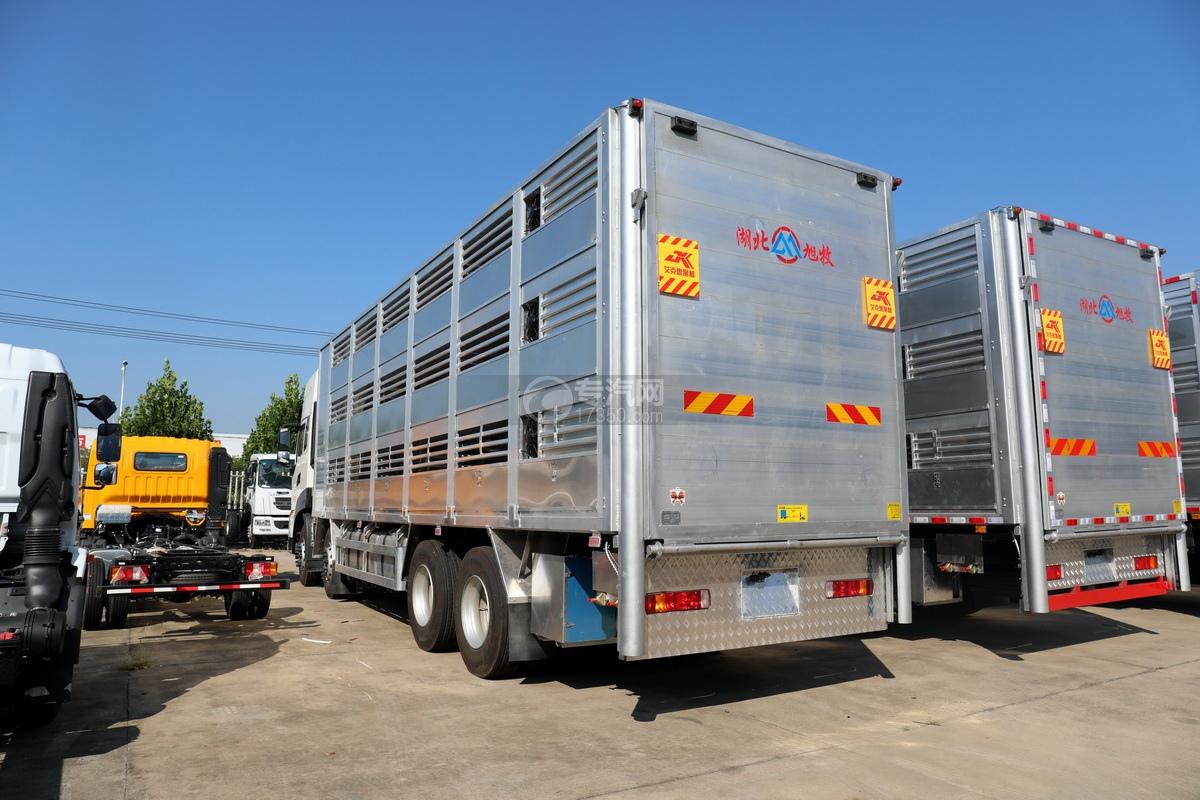 东风天龙KL前四后八国六畜禽运输车左后图